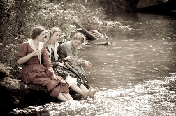 Sepia women by river creek in civil war reenactmen  © Ramon Mascarenas | Dreamstime.com
